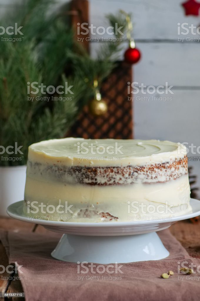 Homemade fruity Hummingbird cake with spices and pecan nuts, Rustic syle. stock photo
