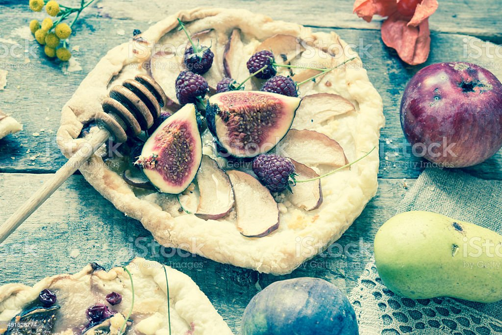 Homemade galetts with fruits figs and apples stock photo
