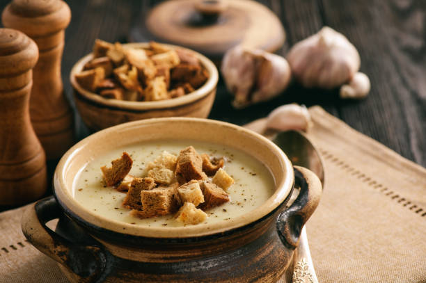 Homemade garlic cream soup with croutons. stock photo