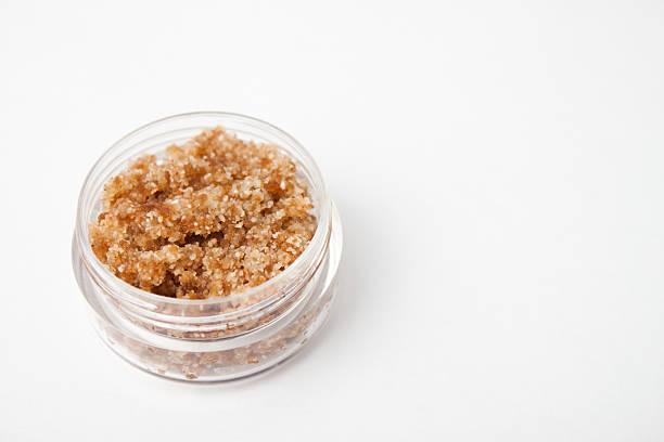 Homemade ginger lip scrub on white surface stock photo