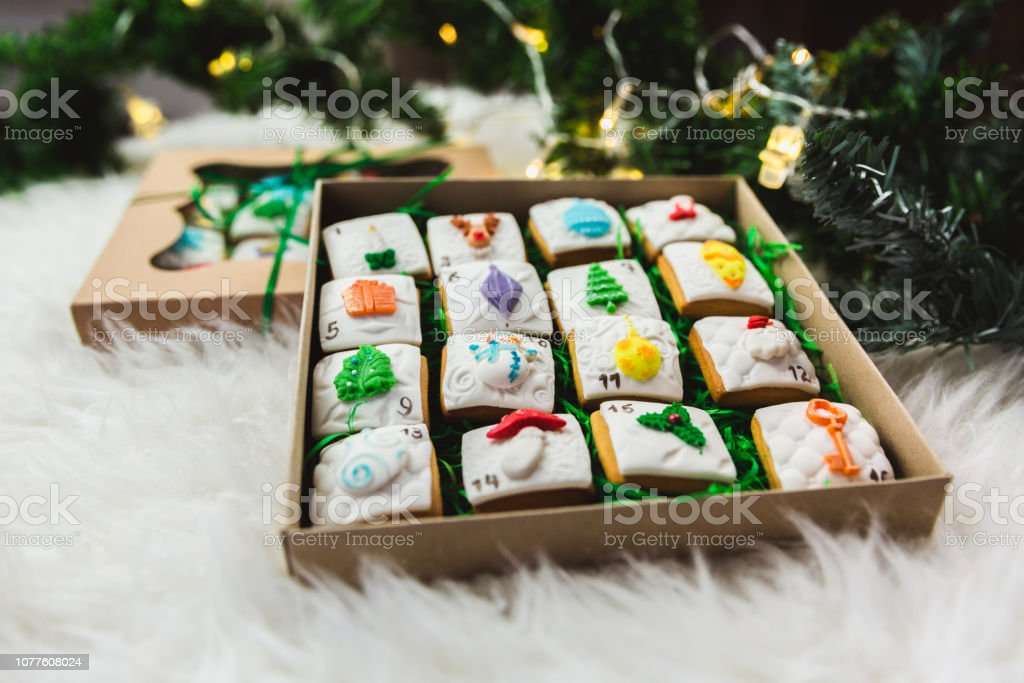 Homemade gingerbread christmas cookies advent calendar on white...