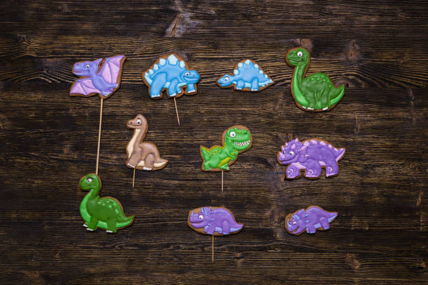 Homemade gingerbread cookies as funny dinosaurs stock photo
