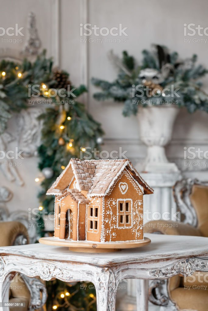 Homemade gingerbread house on background room decorated for Christmas. stock photo