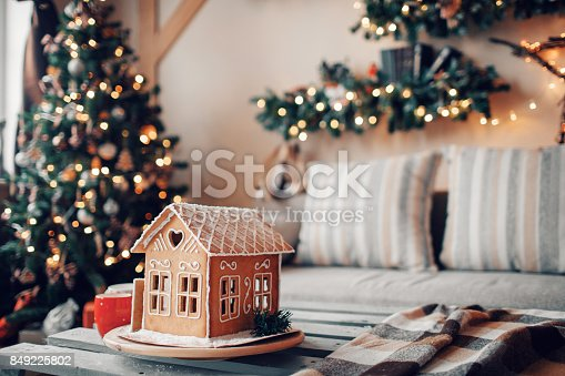 istock Homemade gingerbread house on light room background 849225802