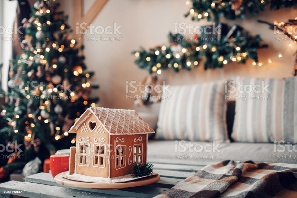 Homemade gingerbread house on light room background stock photo