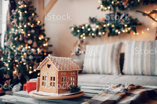 Homemade Gingerbread House On Light Room Background Stock Photo - Download Image Now