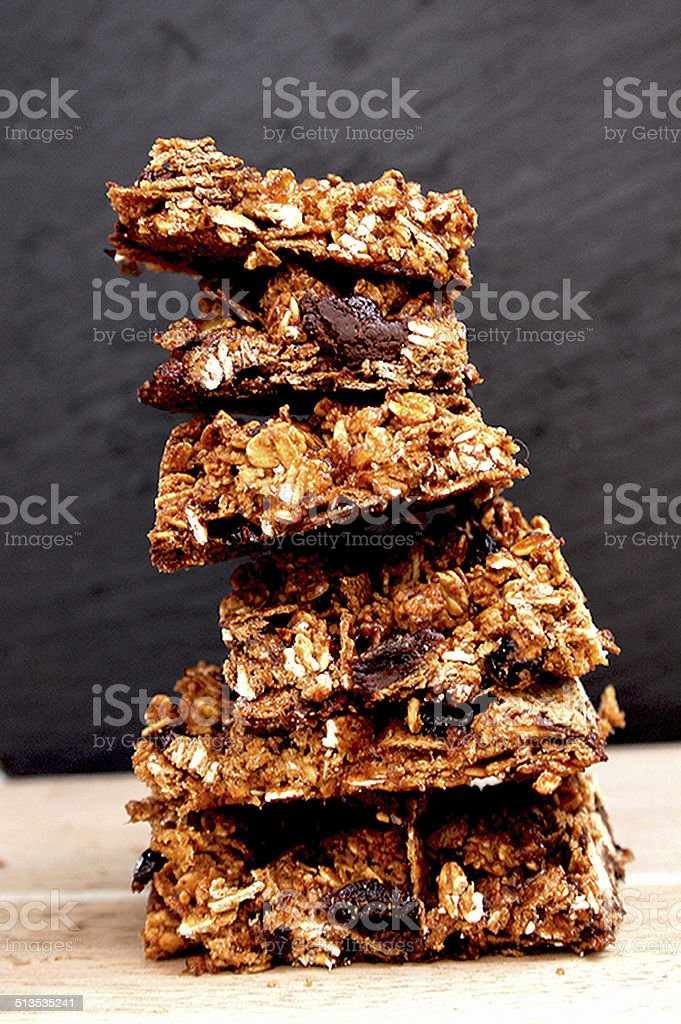 Homemade granola bars with dried fruit, nuts and chocolate stock photo