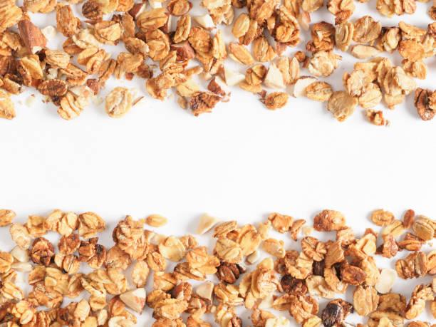 homemade granola isolated on white - granola imagens e fotografias de stock
