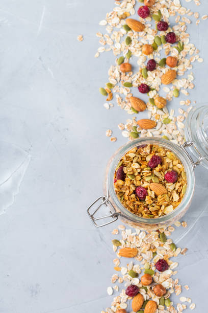 Homemade granola muesli with ingredients, healthy food for breakfast stock photo