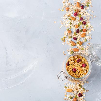 istock Homemade granola muesli with ingredients, healthy food for breakfast 1153858345