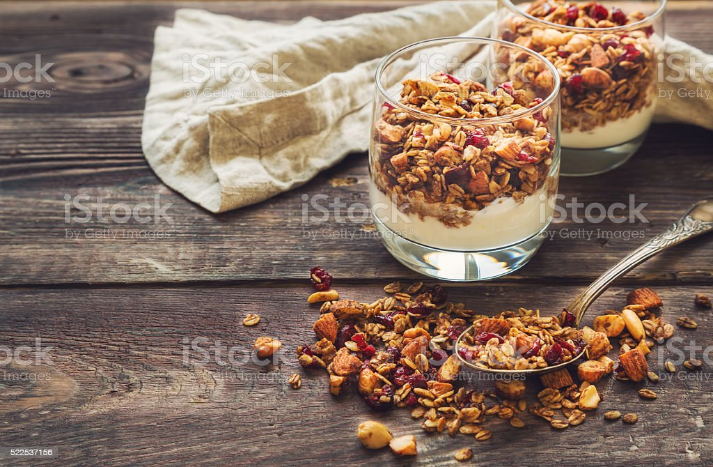 Homemade granola, muesli with yogurt in glasses stock photo