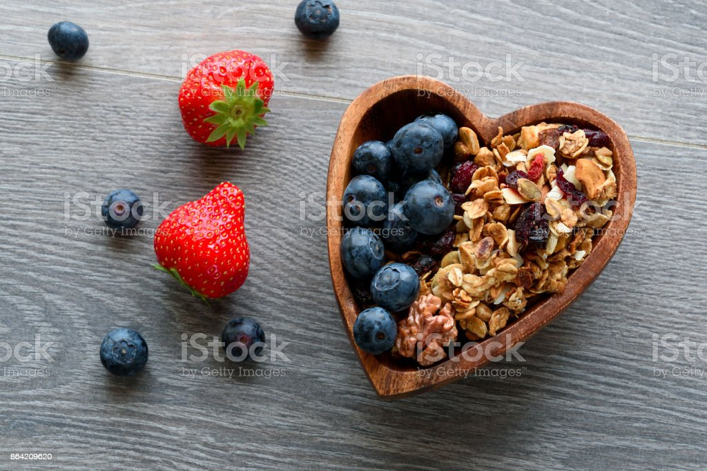 Homemade  granola with  fresh berry in wooden bowl royalty-free stock photo