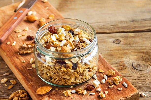 homemade granola with nuts - oats food stock photos and pictures