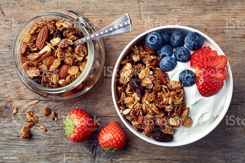Homemade granola with yogurt and fresh berries stock photo