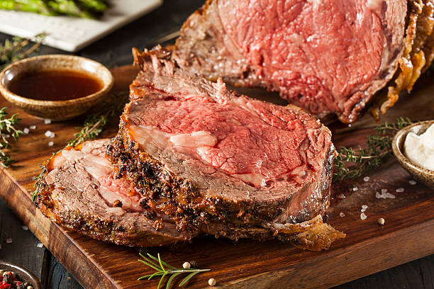 Homemade Grass Fed Prime Rib Roast Homemade Grass Fed Prime Rib Roast with Herbs and Spices roasted prime rib stock pictures, royalty-free photos & images