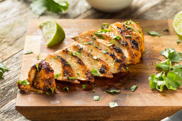 Homemade Grilled Chipotle Chicken Breast Homemade Grilled Chipotle Chicken Breast with Cilantro and LIme grilled chicken breast stock pictures, royalty-free photos & images