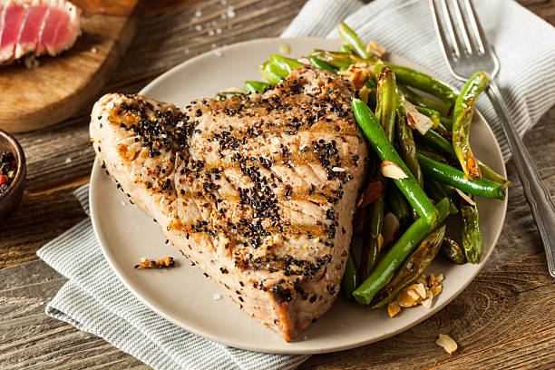 Homemade Grilled Sesame Tuna Steak Homemade Grilled Sesame Tuna Steak with Soy Sauce tuna seafood stock pictures, royalty-free photos & images