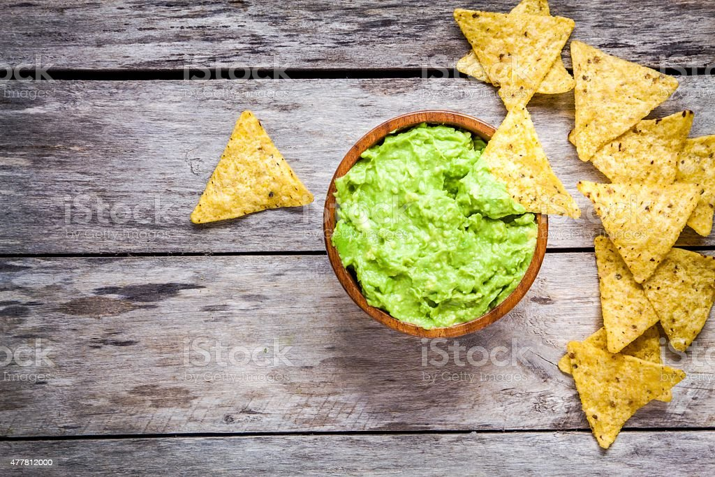 homemade guacamole with corn chips top view stock photo