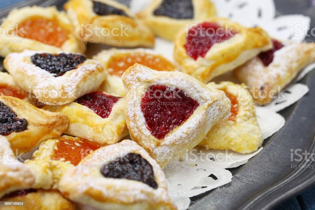 homemade hamantaschen cookies for happy Purim jewish holiday party stock photo