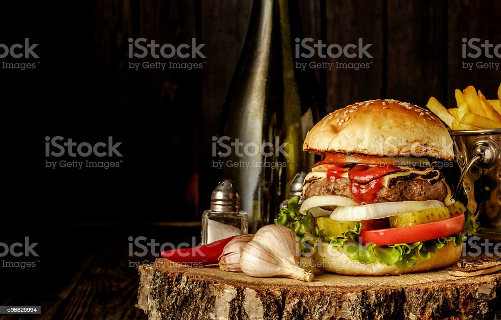 Homemade hamburger with lettuce and cheese. стоковое фото