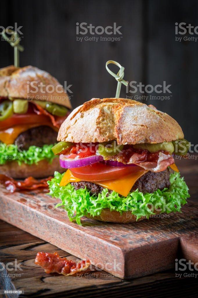 Homemade hamburger with onion, tomato and lettuce stock photo