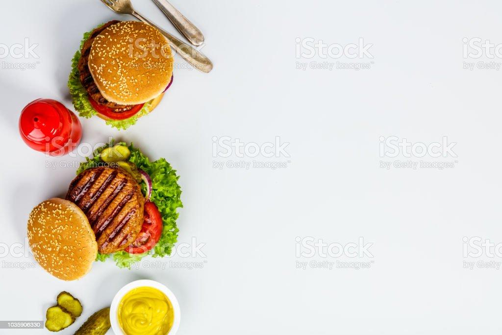 Homemade hamburgers, flat lay stock photo