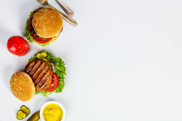 Homemade hamburgers, flat lay stock photo