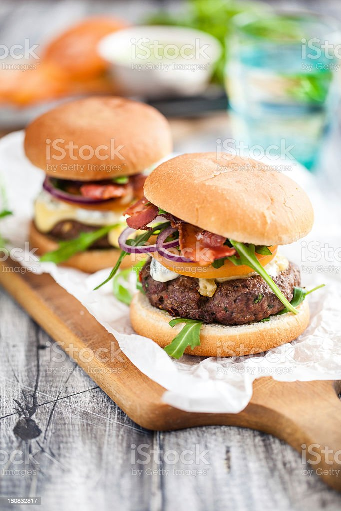 Homemade hamburgers served on a wooden paddle stock photo