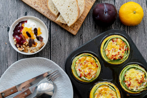 homemade healthy breakfast: cucumber muffin stuffed with egg and shrimp homemade healthy breakfast: cucumber muffin stuffed with egg and shrimp muffin tin stock pictures, royalty-free photos & images