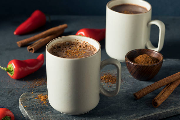 homemade holiday spicy mexican hot chocolate - hot chocolate stock photos and pictures