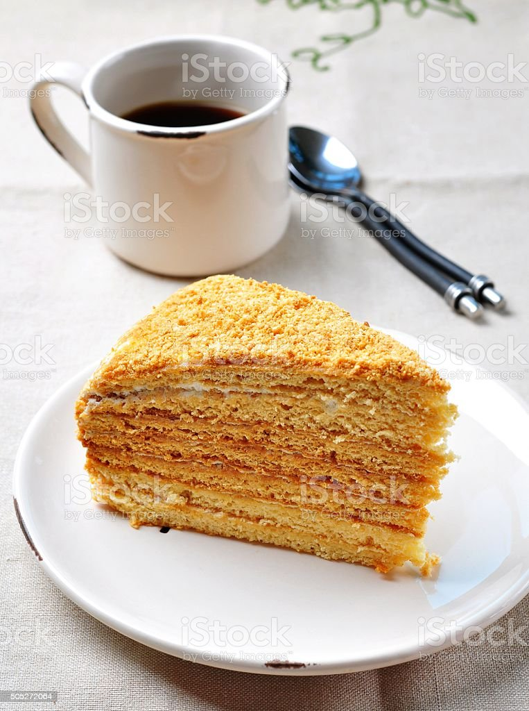 homemade honey cake with a cup of coffee stock photo