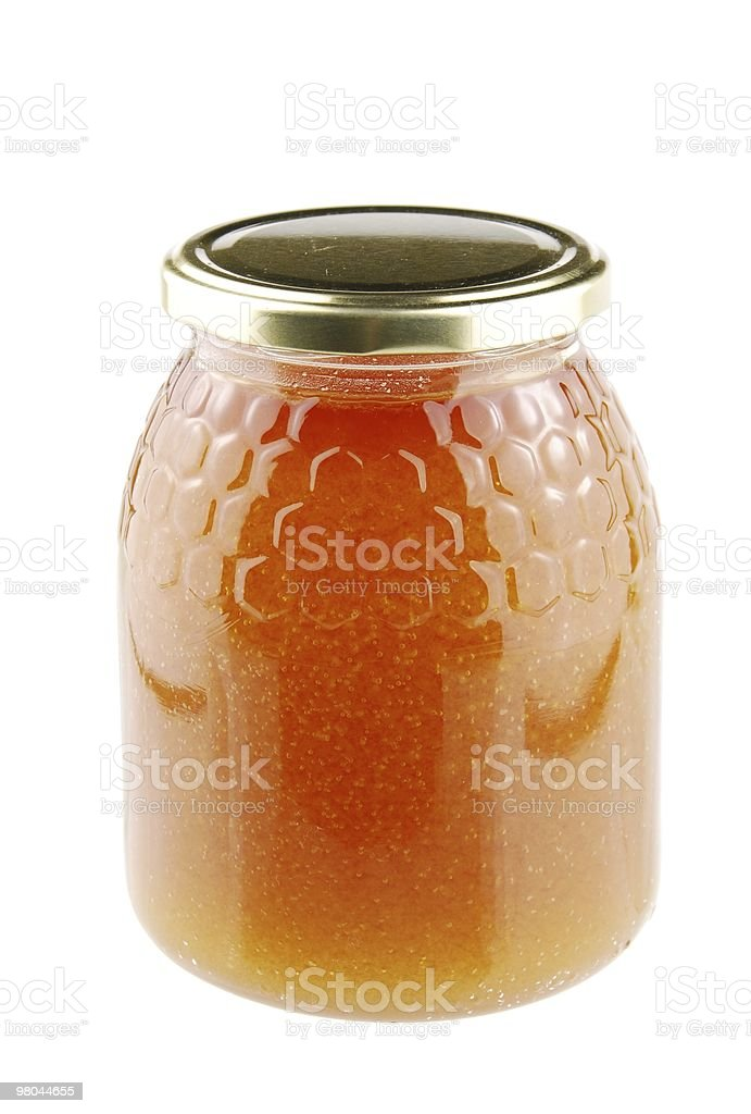 Homemade honey in a glass jar royalty-free stock photo