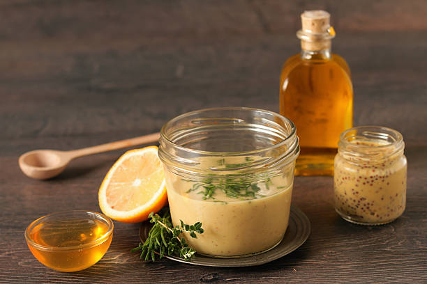 Homemade honey mustard dressing Homemade honey mustard dressing on wooden table salad dressing stock pictures, royalty-free photos & images
