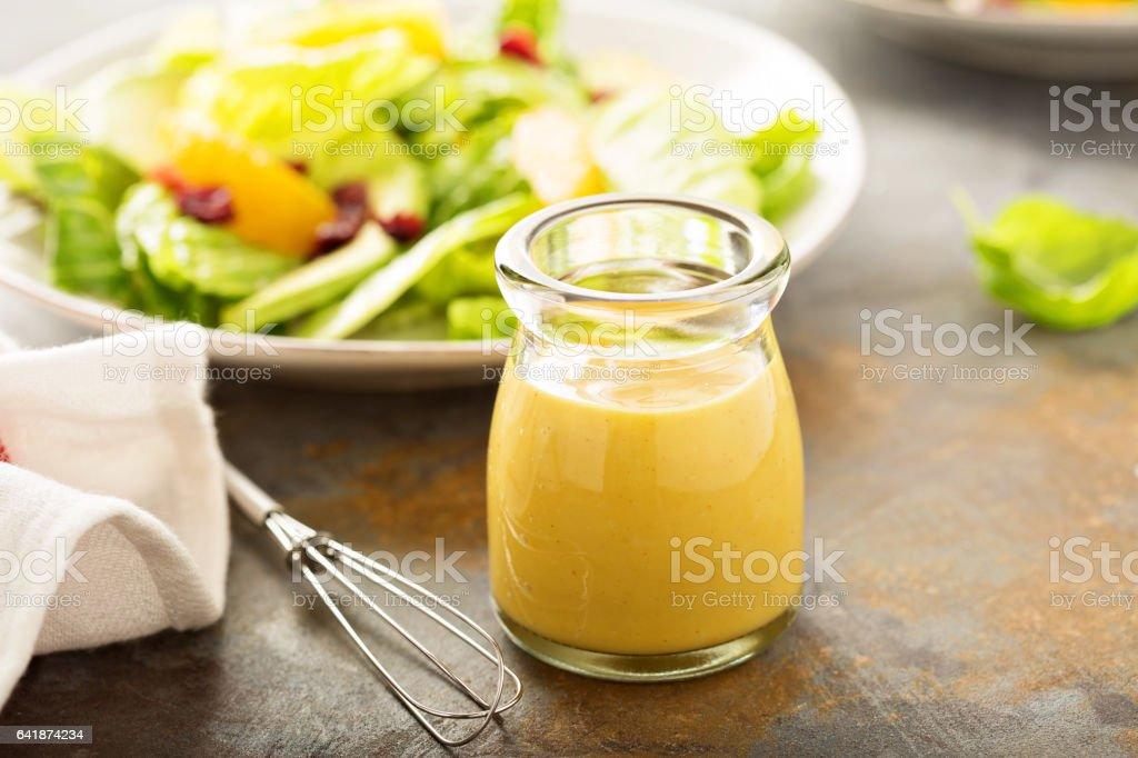 Homemade honey mustard salad dressing stock photo