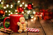 istock Homemade hot chocolate mug and gingerbread cookies on Christmas table 1170759441