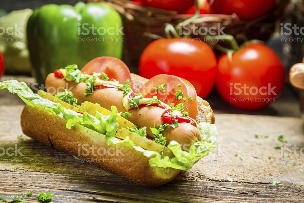 Homemade hot dog with a lot of vegetables royalty-free stock photo