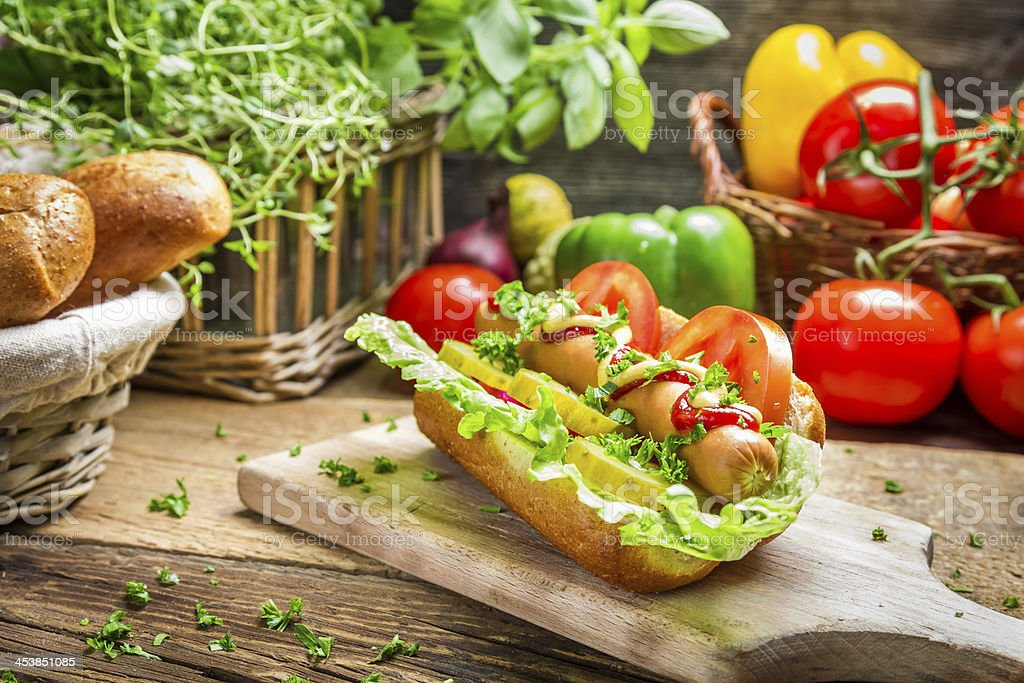 Homemade hot dog with fresh ingredients royalty-free stock photo
