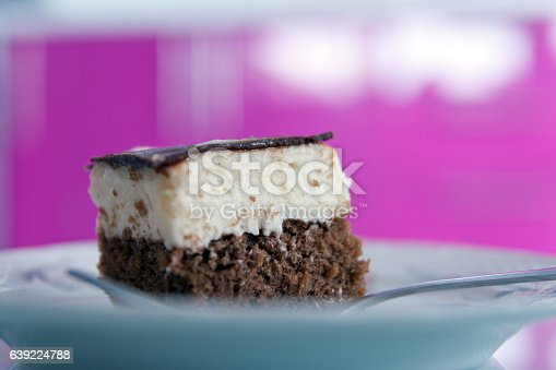 Homemade Ice Cream Cake, white plate, fork on white table with pink background