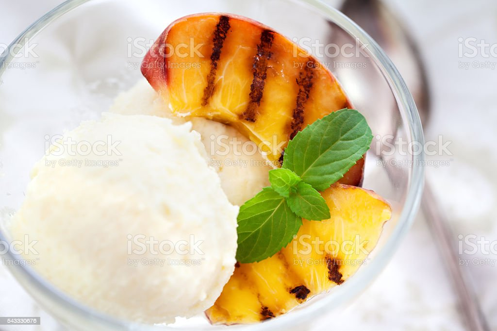 Homemade Ice Cream with  grilled Peach  and mint stock photo