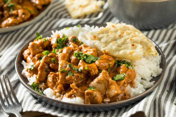 Homemade Indian Butter Chicken with Rice Homemade Indian Butter Chicken with Rice and Naan Bread butter chicken stock pictures, royalty-free photos & images