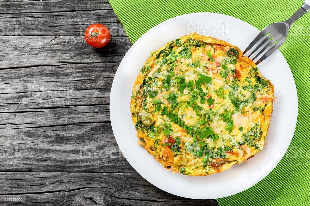 Homemade Italian terrific frittata  with eggs, ricotta, onon, to stock photo