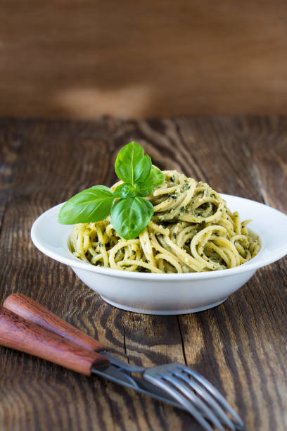 homemade italian traditional pasta with pesto sauce - oli, aromi e spezie foto e immagini stock