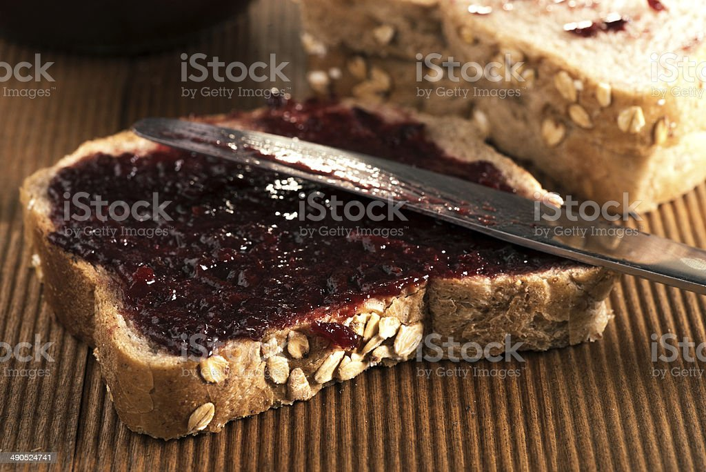 Homemade jam on  integral bread. stock photo