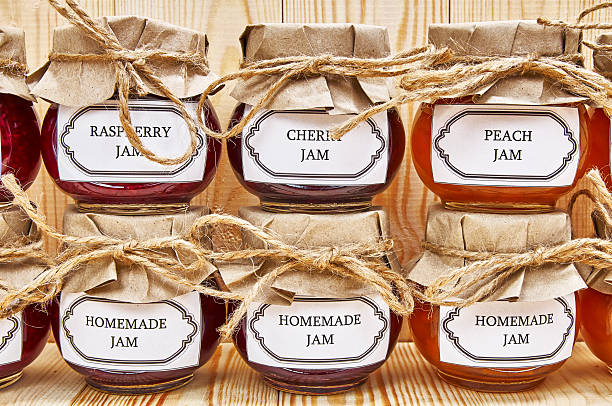 Homemade jams on a wooden shelf stock photo