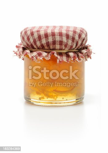 Small jar of homemade orange marmalade isolated on white