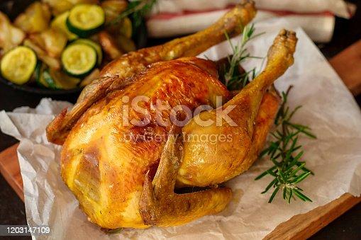 Homemade juicy roast chicken with rosemary and garlic