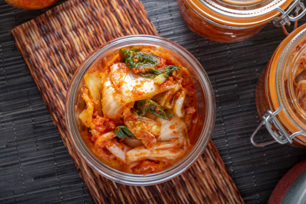 Homemade Kimchee Kimchee in glass jar brassica rapa stock pictures, royalty-free photos & images