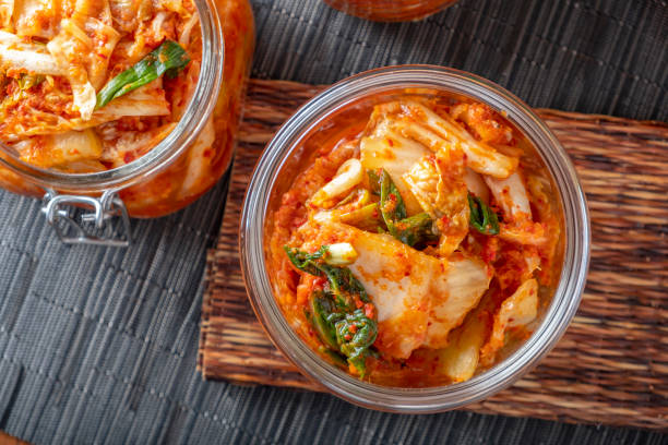 Homemade Kimchee Kimchee in glass jar fermenting stock pictures, royalty-free photos & images