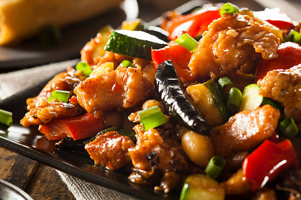 homemade kung pao chicken - chinese food stock photos and pictures
