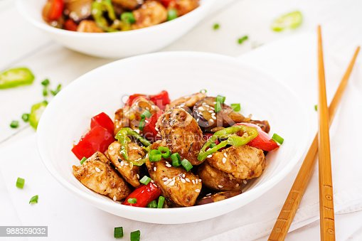 Homemade kung pao chicken with peppers and vegetables. Chinese food. Stir fry.